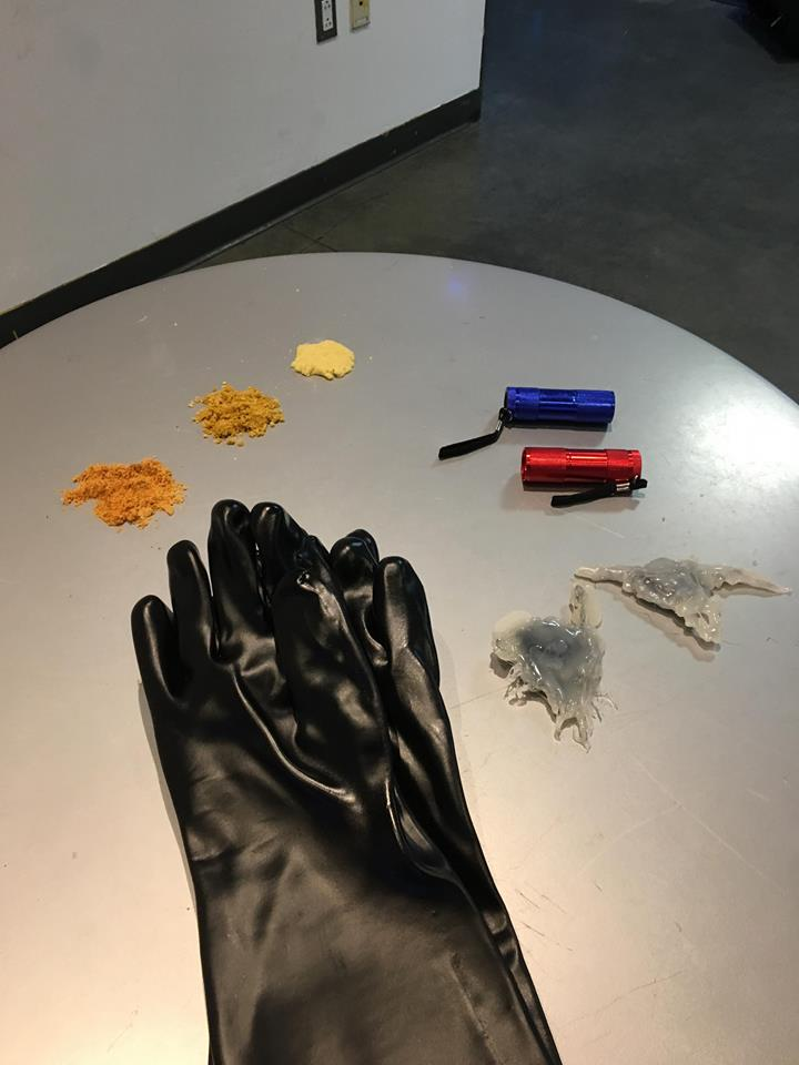 The gloves, biliopii, and fake sand